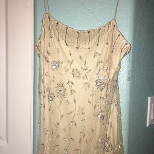 Gown cream colored comes with see through shaw